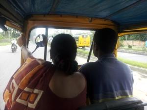 Inside the auto-rickshaw to work
