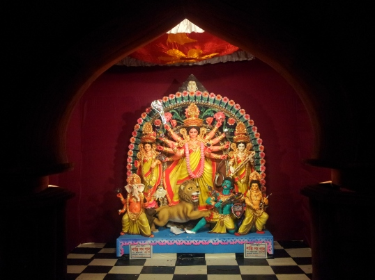 Ganesh and Lakshmi on the left, Durga with Mahisasur in the middle and Saraswati with Kartik on the right