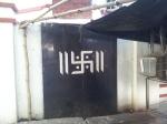 Swastika on a house door near Ghariahat, Kolkata