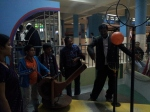 A kid trying trying out an exhibit in Dynamiton hall